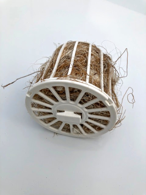 picture of plastic white nesting material holder